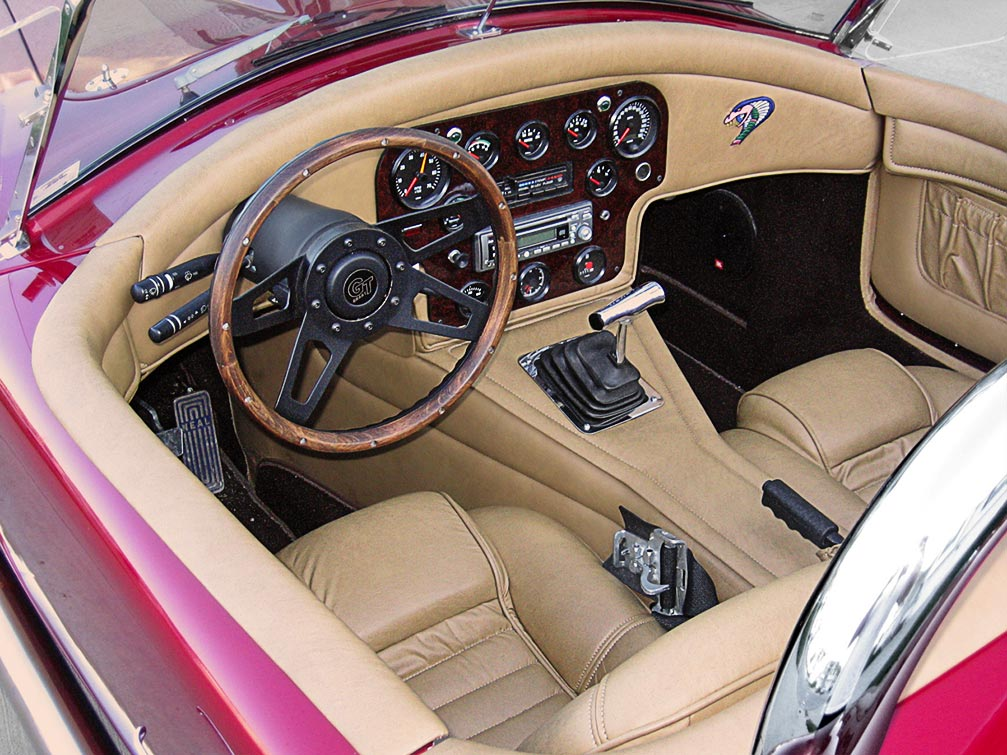 cockpit shot (from driver side) of Candy Apple Red West Coast 427SC Shelby classic Cobra for sale