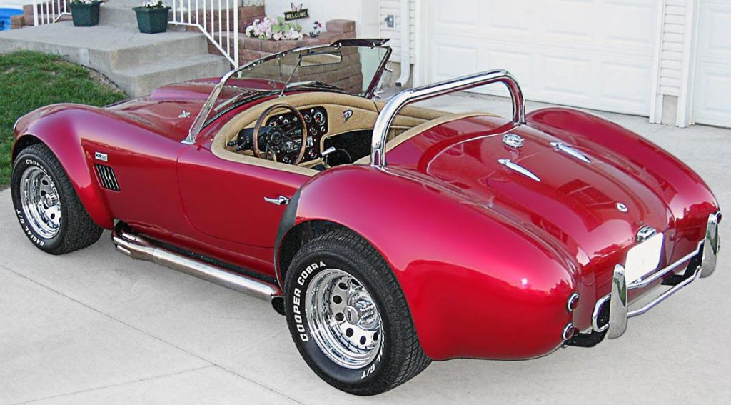 3/4-rear shot (driver side) of Candy Apple Red West Coast 427SC Shelby classic Cobra for sale