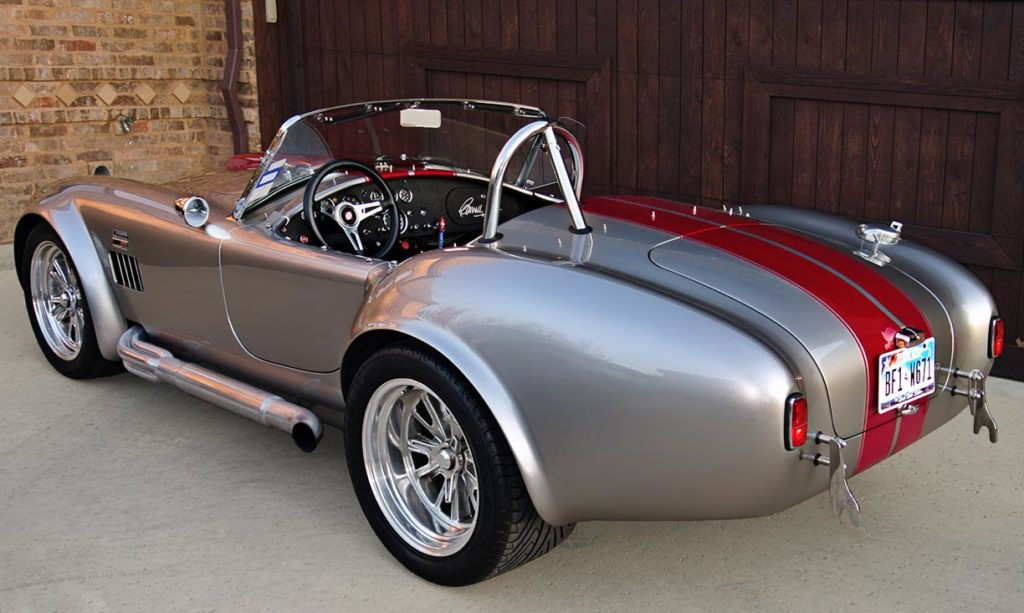 3/4-rear shot (driver side) of Titanium/deep red stripes Superformance 427SC Shelby classic Cobra for sale by owner, SPO2281