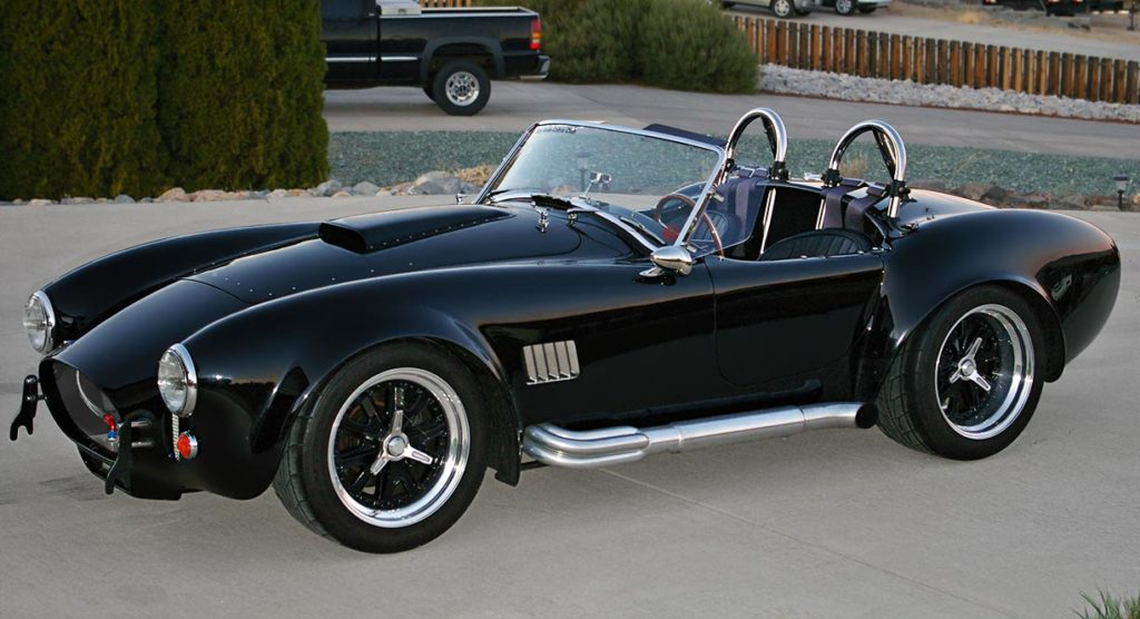 3/4-frontal shot (driver side) of Onyx Black Superformance 427SC MkIII Shelby classic Cobra for sale, SPO1948