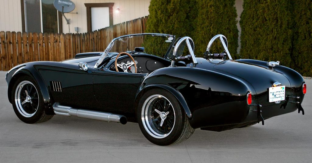 3/4-rear shot of Onyx Black Superformance 427SC MkIII Shelby classic Cobra for sale, SPO1948