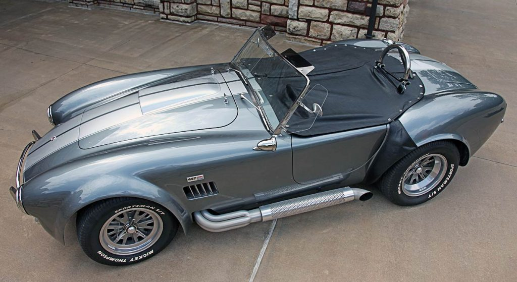 aerial broadside shot (from driver side) of dark gray 10th Anniversary Edition Superformance 427SC Shelby classic Cobra for sale, SPO1948