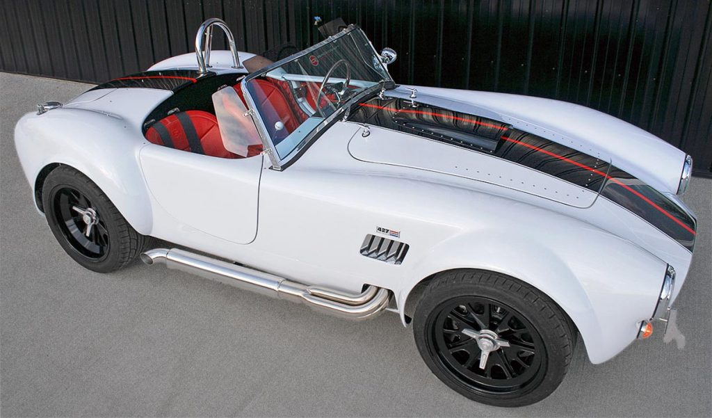 broadside shot of white Backdraft Racing 427SC Shelby classic Cobra for sale, BDRxxx