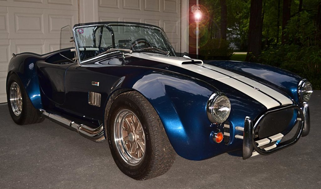 3/4-frontal shot (passenger side) of Navy Blue/Arctic White stripes 427SC Shelby classic Cobra (by Shell Valley Companies) for sale by owner