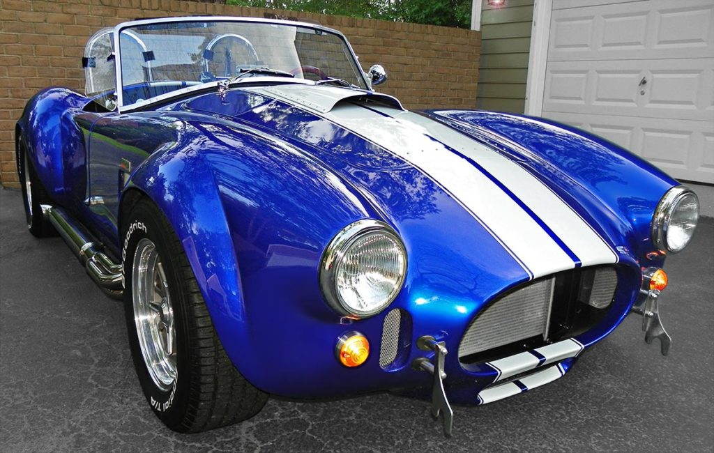 3/4-frontal shot (passenger side, alternate angle) of Speedway Blue Backdraft Racing classic Shelby Cobra Vehicle for sale by owner