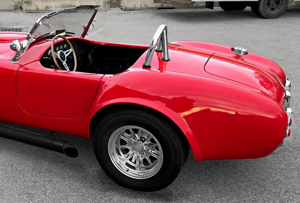 rear-quarter (driver side) shot of Hot Red Antique & Classic 427SC Shelby classic Cobra replica for sale