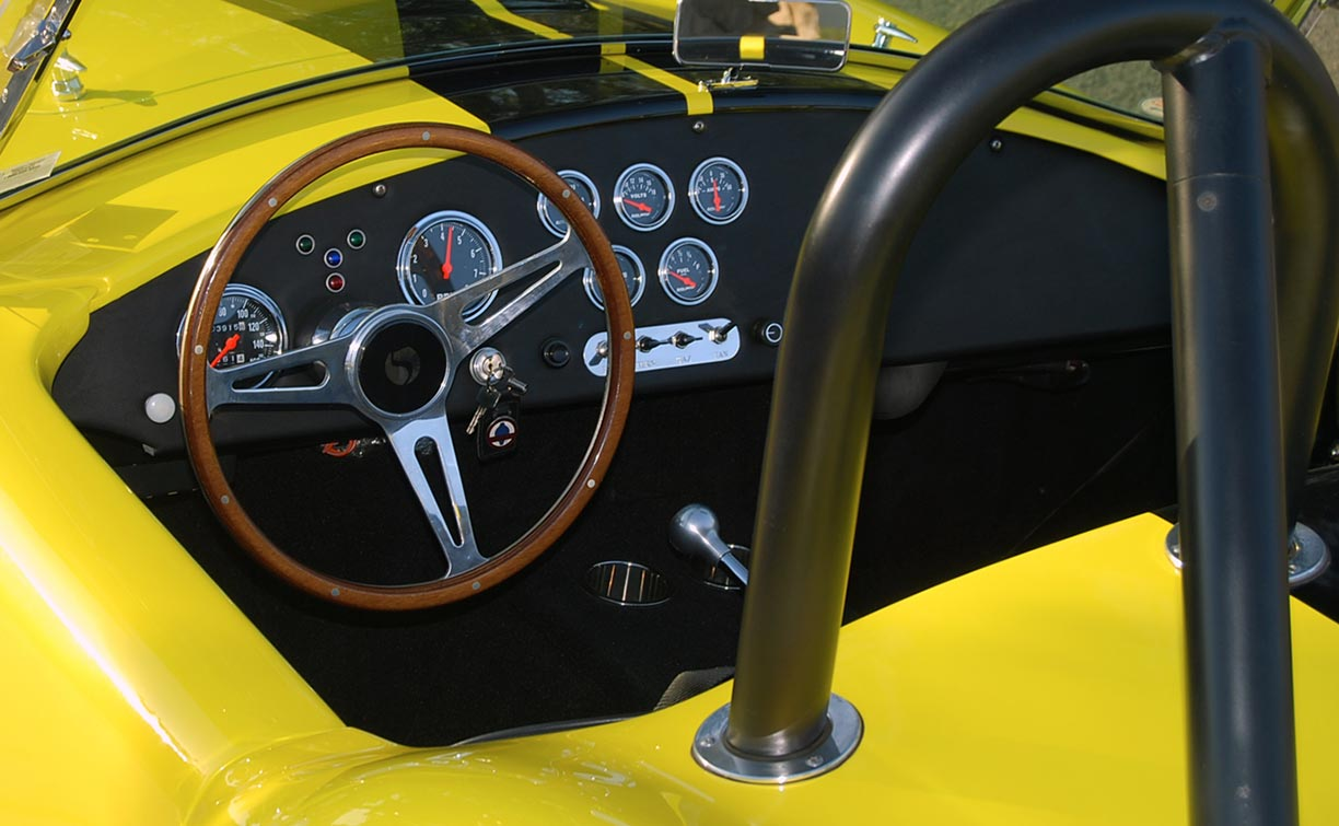dashboard photo of Candy Lime Gold FFR (Factory Five Racing) 427SC Shelby classic Cobra for sale by owner