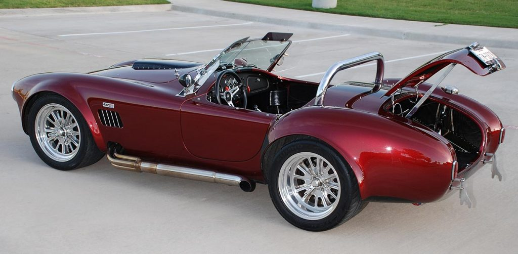 broadside (trunk open) shot of Primal Red Pearl E.R.A. 427SC Shelby classic Cobra for sale, ERA462