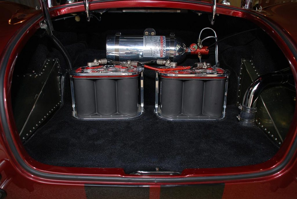 trunk/gel batteries/ fire suppression system shot of Primal Red Pearl E.R.A. 427SC Shelby classic Cobra for sale, ERA462