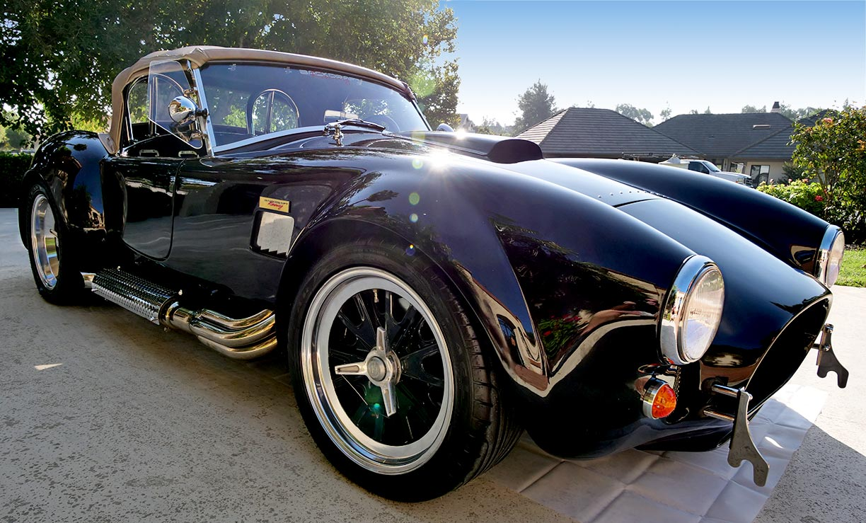 3/4-frontal shot (passenger side) of black Backdraft Racing 427SC Shelby classic Cobra for sale by owner