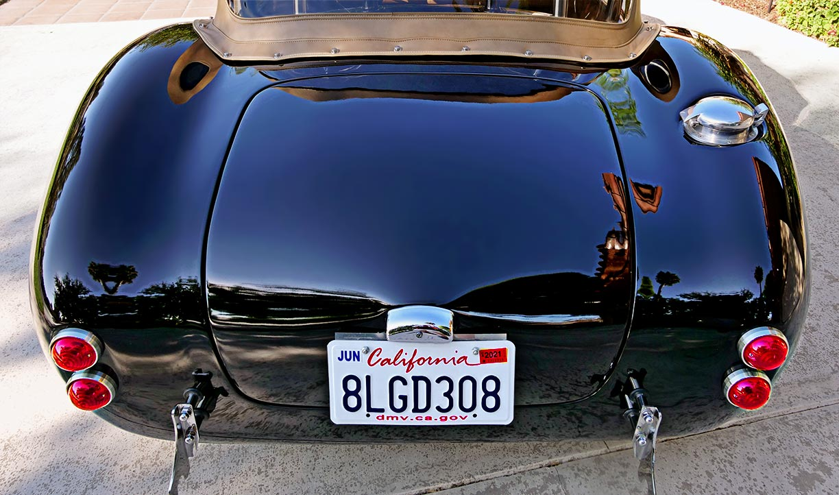 rear shot of black Backdraft Racing 427SC Shelby classic Cobra for sale by owner