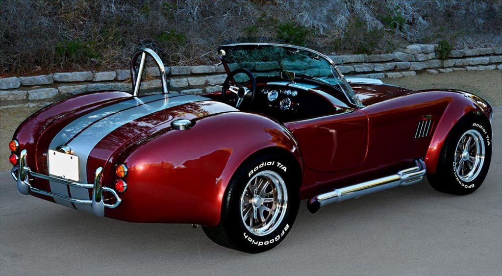 3/4-rear shot (passenger side) of Crimson Red Backdraft Racing 427SC Shelby classic Cobra for sale, BDR089