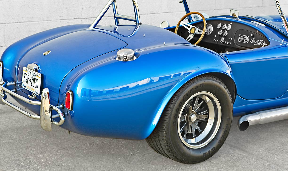 rear-quarter view (passenger side) of 40th Anniversary 427SC Shelby Cobra for sale, CSX4338, painted in Anniversary Blue