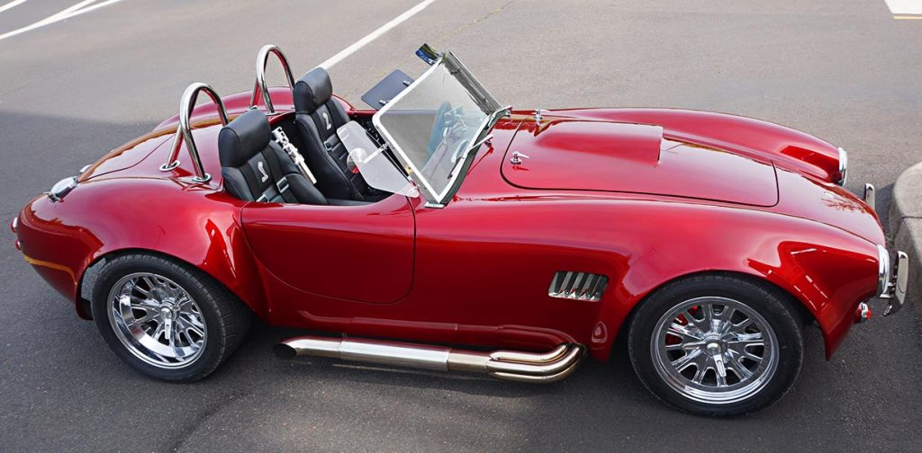 broadside shot of Ruby Red Pacific Roadster 427SC Shelby classic Cobra for sale