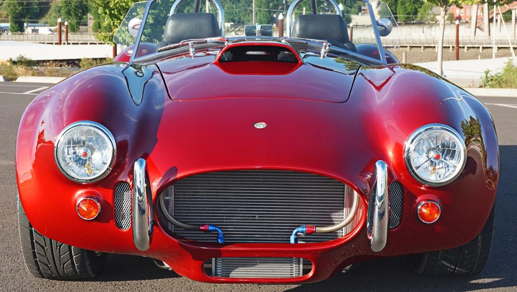 head-on frontal shot of Ruby Red Pacific Roadster 427SC Shelby classic Cobra for sale