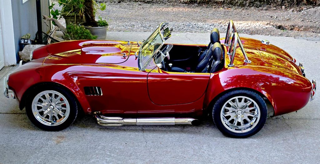 broadside shot (driver side) of Ruby Red Pacific Roadster 427SC Shelby classic Cobra for sale