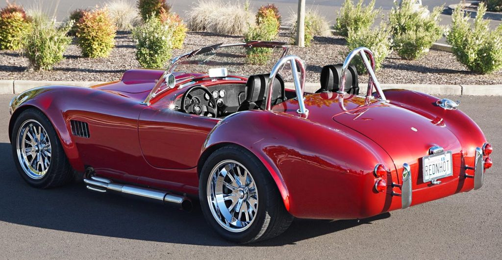 3/4-rear shot of Ruby Red Pacific Roadster 427SC Shelby classic Cobra for sale