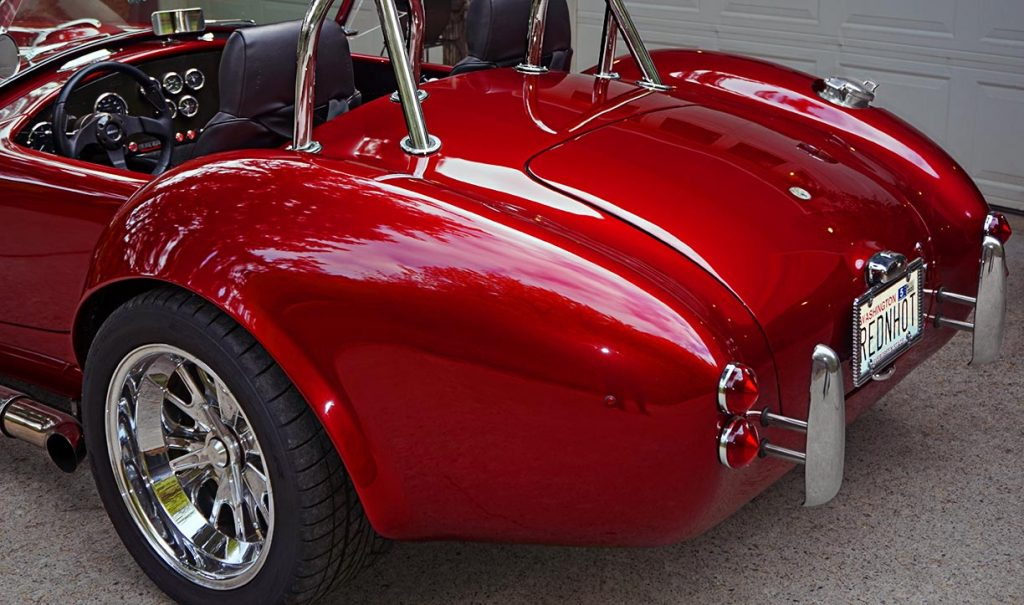 rear quarter shot of Ruby Red Pacific Roadster 427SC Shelby classic Cobra for sale