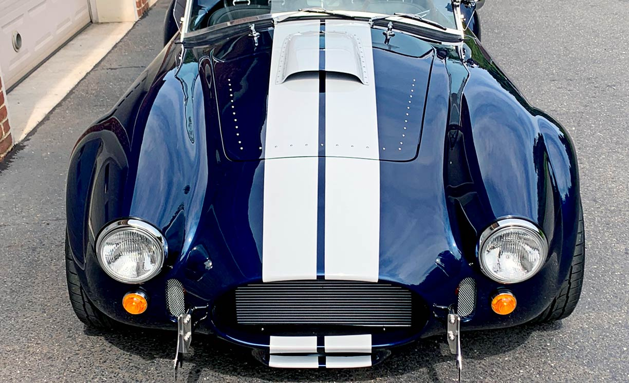head-on frontal shot of Indigo Blue/white stripes Backdraft Racing 427SC Shelby classic Cobra replica for sale by owner, BDR2092