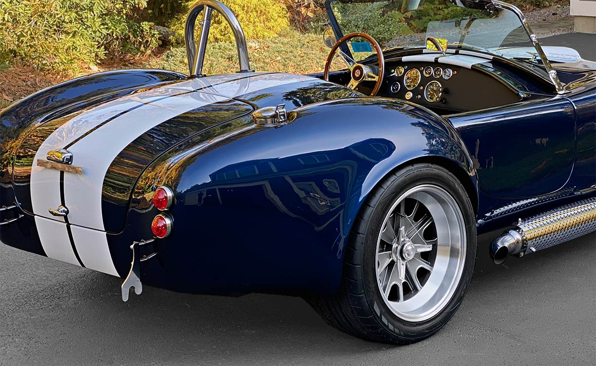 rear-quarter shot (passenger side) of Indigo Blue/white stripes Backdraft Racing 427SC Shelby classic Cobra replica for sale by owner, BDR2092