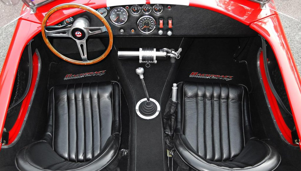 overhead cockpit shot of Rosso Red Backdraft Racing 427SC Shelby classic Cobra for sale