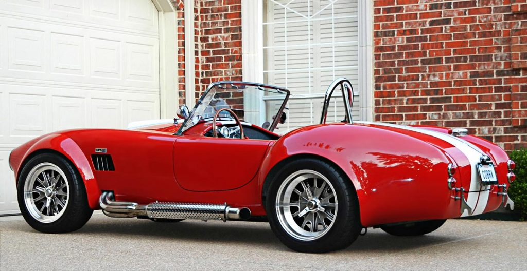 3/4-rear shot (driver side) of Rosso Red Backdraft Racing 427SC Shelby classic Cobra for sale