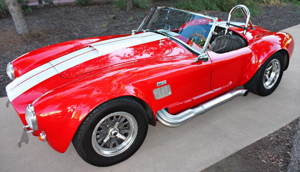 broadside shot (driver side) of Guards Red Hi-Tech Motorsports 427SC Shelby classic Cobra for sale by owner
