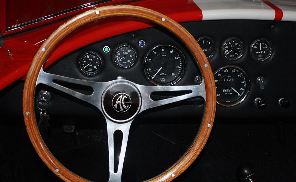 dashboard shot of Guards Red Hi-Tech Motorsports 427SC Shelby classic Cobra for sale by owner