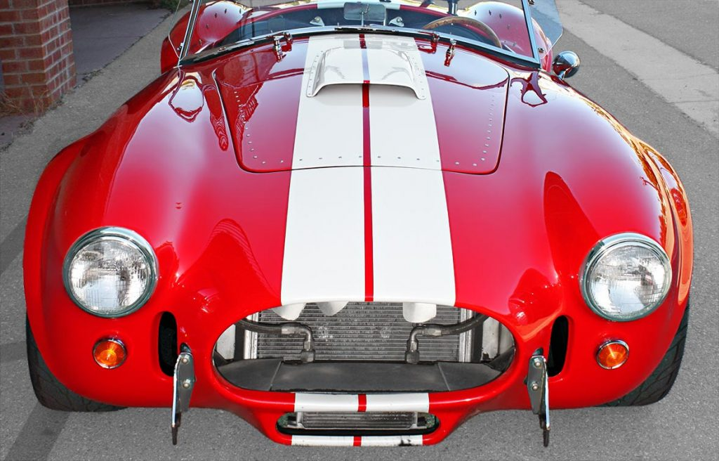 head-on frontal shot of Guards Red Hi-Tech Motorsports 427SC Shelby classic Cobra for sale by owner