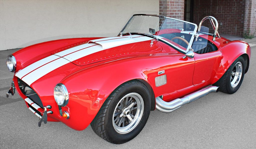 3/4-frontal shot (driver side) of Guards Red Hi-Tech Motorsports 427SC Shelby classic Cobra for sale by owner