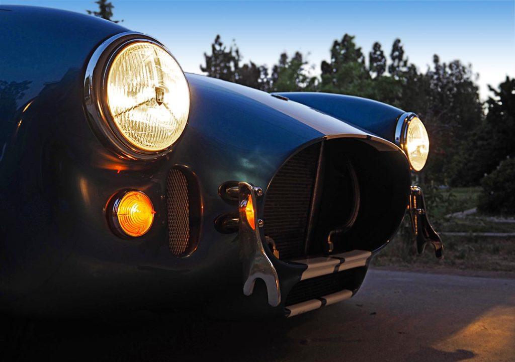 """tripod headlamps in twilight"" shot of Guardsman Blue/white stripes Superformance 427SC Cobra for sale, SPO3164"