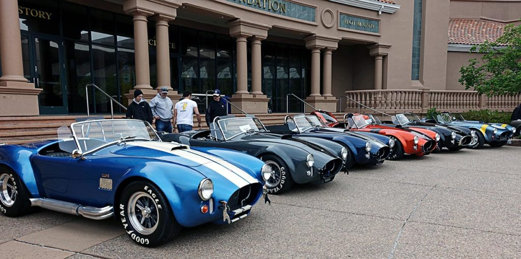 Guardsman Blue/white stripes Superformance 427SC Cobra for sale, SPO3164 in lineup with five other Cobras