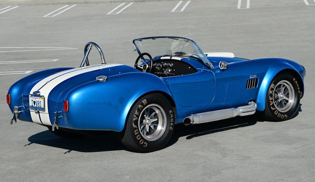 3/4-rear view of Guardsman Blue/white stripes Superformance 427SC Cobra for sale, SPO3164