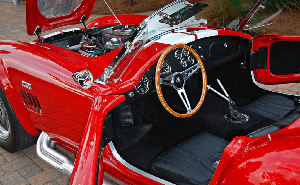 cockpit shot (with all decks open) of Phoenix Red E.R.A. 427SC Shelby Cobra vehicle for sale by owner