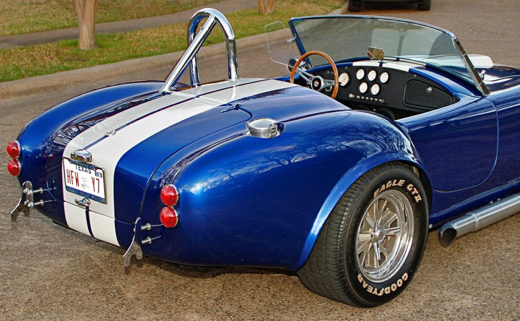 rear-quarter shot (passenger side, alternate angle) of Prussian Blue Factory Five Racing 427SC Cobra for sale by owner