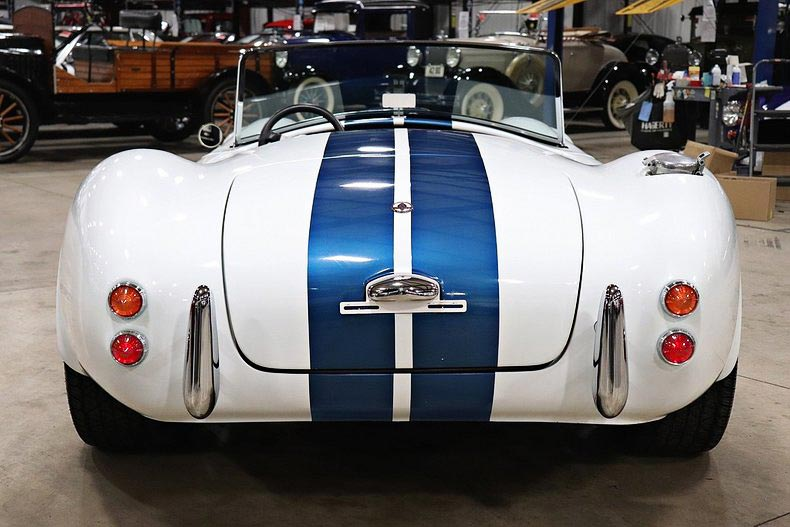 head-on rear shot of Grand Prix White/LeMans Blue stripes Classic Roadsters 427SC Shelby classic Cobra for sale by owner