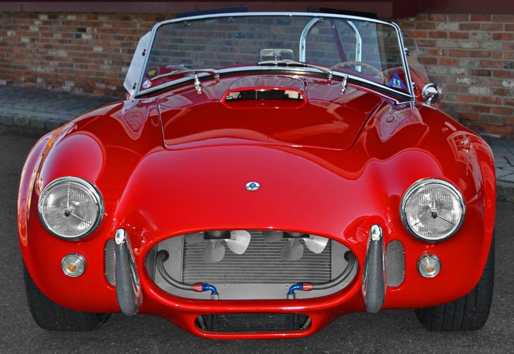 head-on frontal shot of Red ERA (E.R.A., Era Replica Automobiles) 427SC Cobra for sale