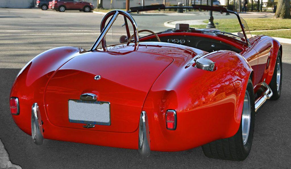 3/4-rearview shot (passenger side) of Red ERA (E.R.A., Era Replica Automobiles) 427SC Cobra for sale