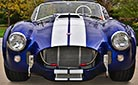classic Shelby Cobra Vehicle (frontal shot, thumbnail image): Superformance MkIII 427SCCobra, SPO1996,Royal Blue/White LeMans stripes, for sale by owner.