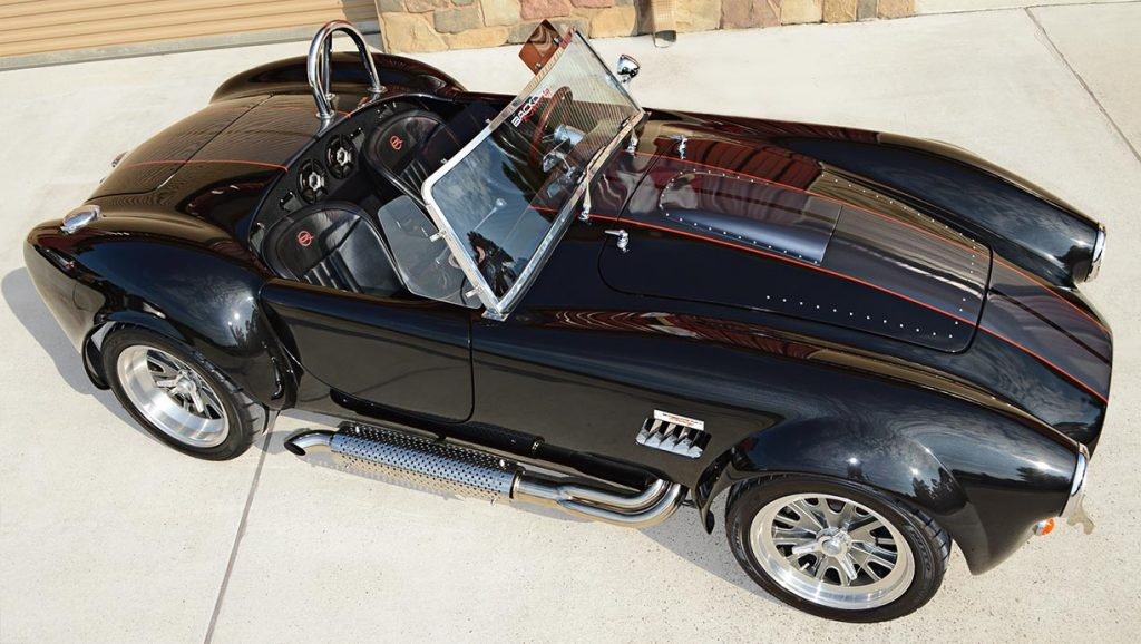 aerial broadside shot of Black Magic Backdraft Racing 427SC Shelby classic Cobra for sale, BDR1050