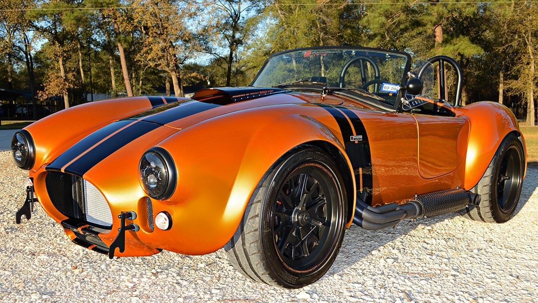 3/4-frontal shot (driver side) of Giallo Capri (bronze) Backdraft Racing 427SC Shelby classic Cobra replica for sale, BDR1477