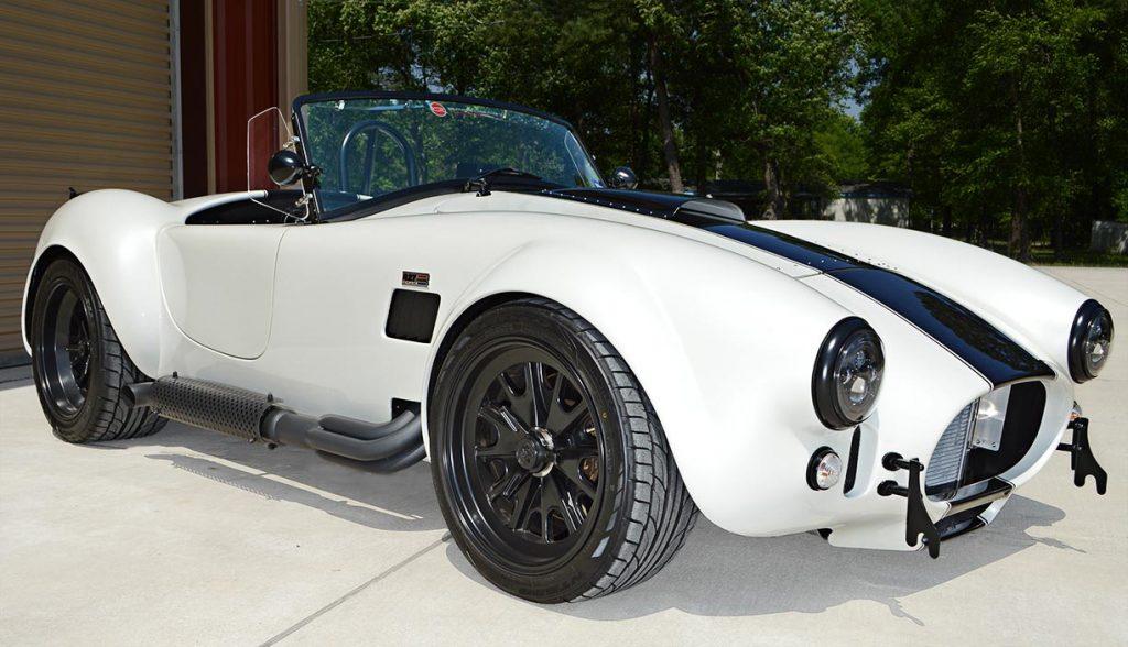3/4-frontal shot (passenger side) of Diamond White Backdraft Racing 427 Shelby classic Cobra Roadster for sale, BDR1751