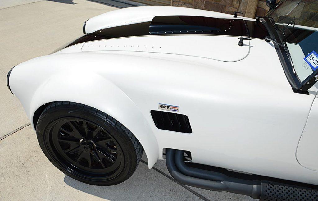 front-quarter shot of Diamond White Backdraft Racing 427 Shelby classic Cobra Roadster for sale, BDR1751