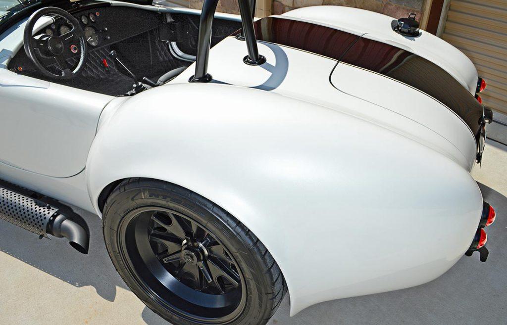 rear-quarter shot#2 (passenger side) of Diamond White Backdraft Racing 427 Shelby classic Cobra Roadster for sale, BDR1751