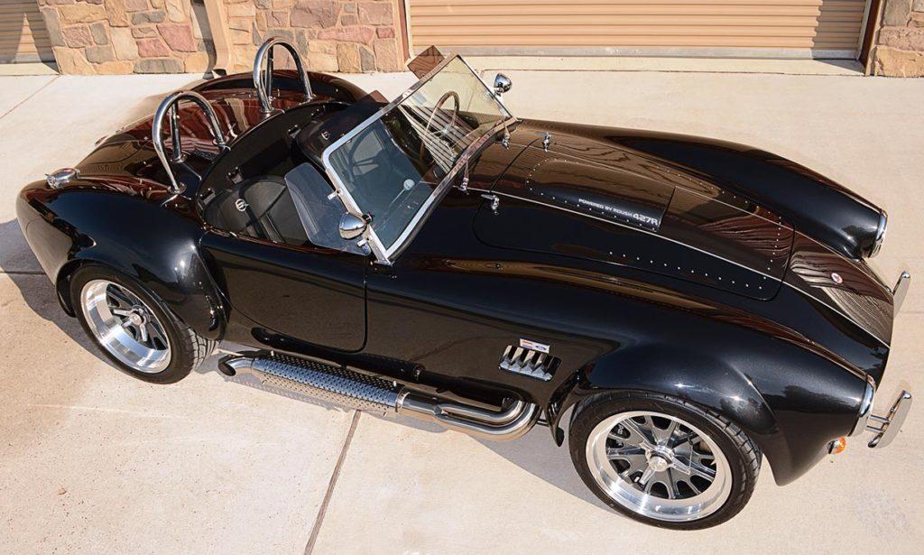 overhead broadside shot of black Backdraft Racing 427SC Cobra for sale, BDR1792