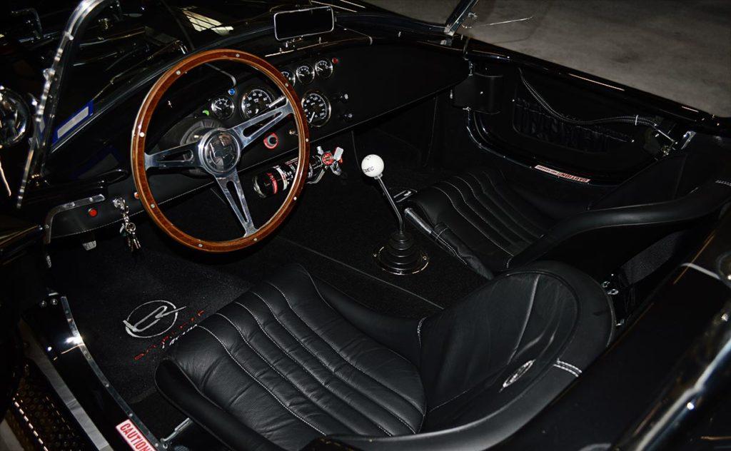cockpit photo (from driver side) of black Backdraft Racing 427SC Cobra for sale, BDR1792