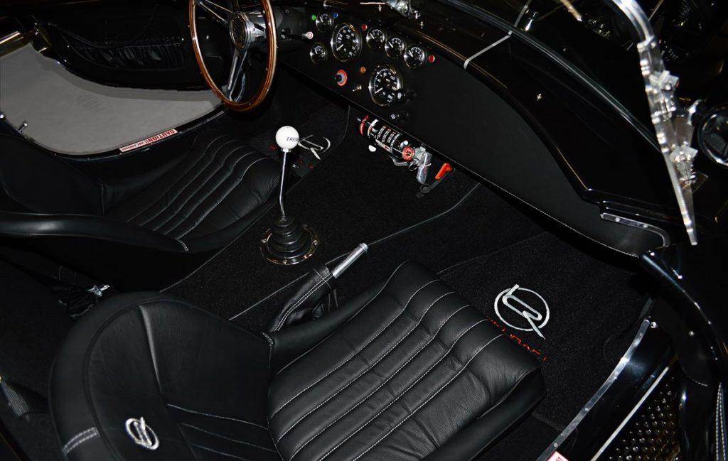 cockpit photo (from passenger side) of black Backdraft Racing 427SC Cobra for sale, BDR1792