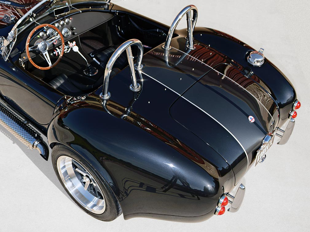 rear-quarter shot (driver side) of black Backdraft Racing 427SC Cobra for sale, BDR1792