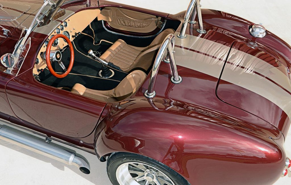 rear-quarter shot (driver side) of Prism Red Backdraft Racing replica of Shelby classsic 427SC Cobra for sale, BDR625