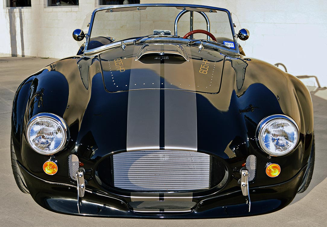 head-on frontal shot of Onyx Black Backdraft Racing 427SC Shelby classic Cobra replica for sale, BDR752